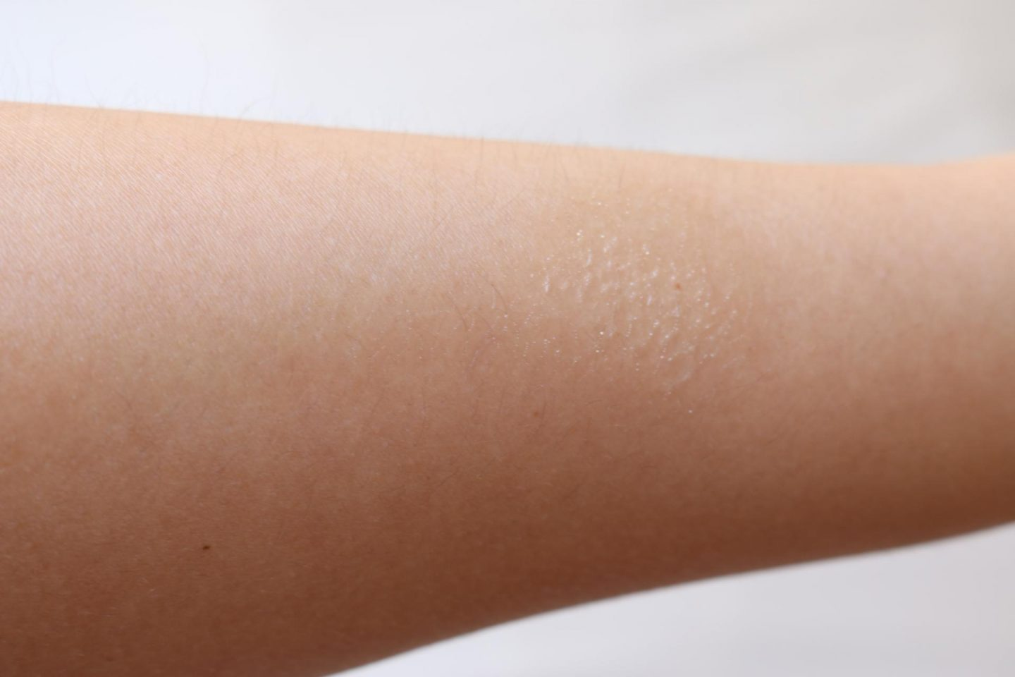 Sports Invisible Protective Mist SPF50+ swatched on my arm